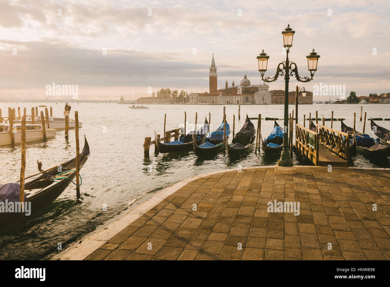 Gondolas in Grand Canal, San Giorgio Maggiore Island in background, Venice, Italy - Stock Image