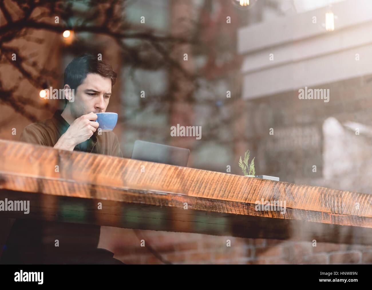 Man having coffee at cafe - Stock Image