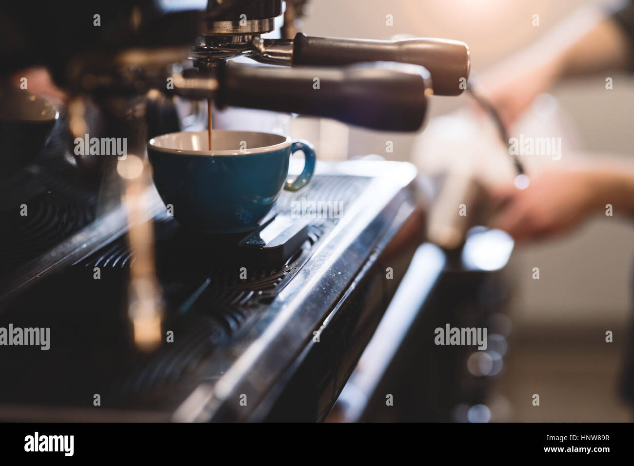 Coffee machine filling cup - Stock Image