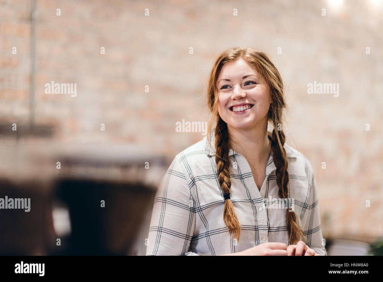 Happy young woman with pigtails - Stock Image