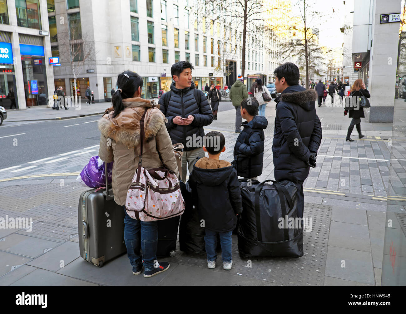 Chinese family stranded during 20 Jan 2017 taxi driver protest over proposal to block Bank Junction access to cabs - Stock Image