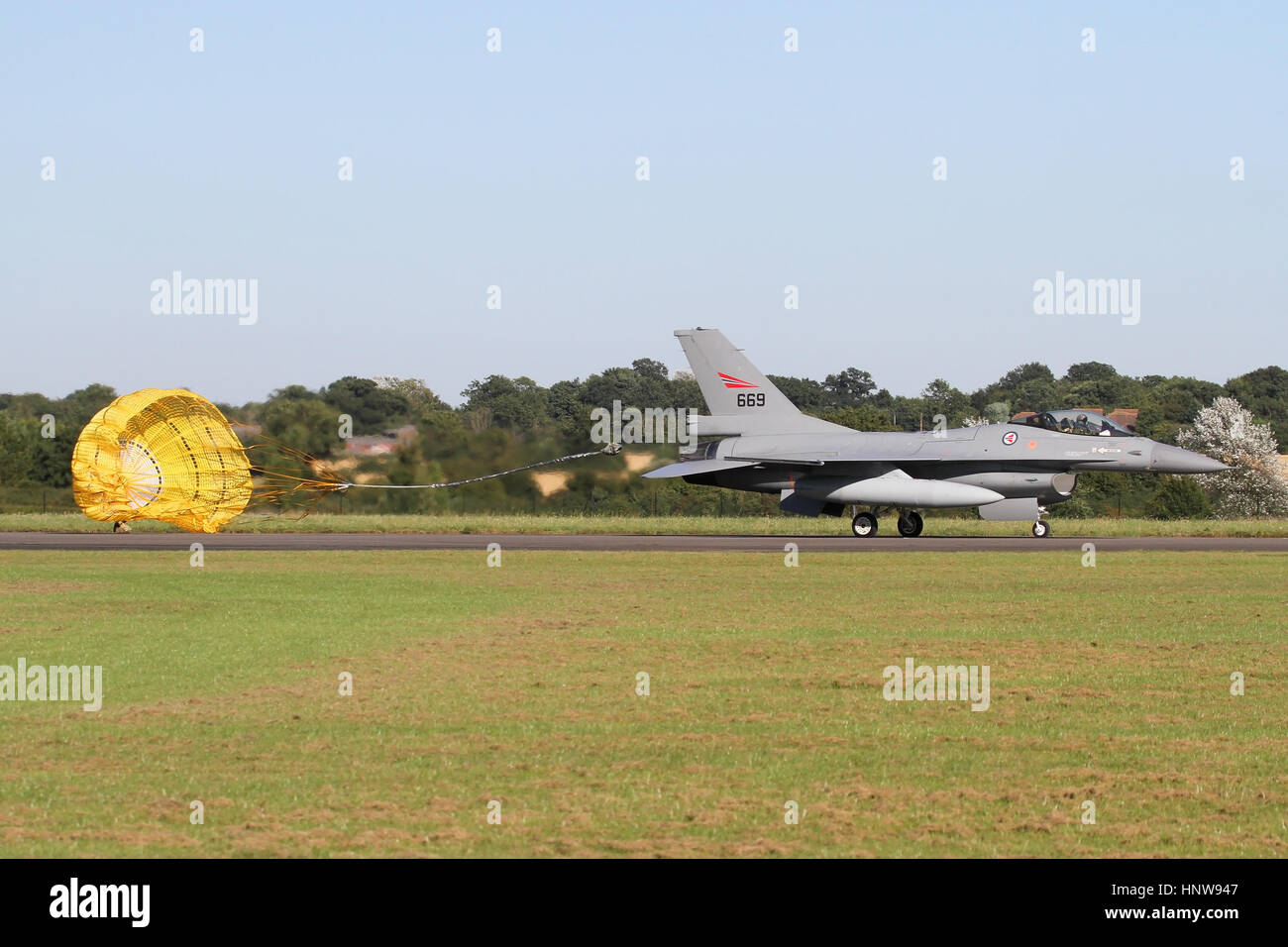 Royal Norwegian Air Force F-16AM dropping it's brake chute after landing at North Weald Airfield in Essex for - Stock Image