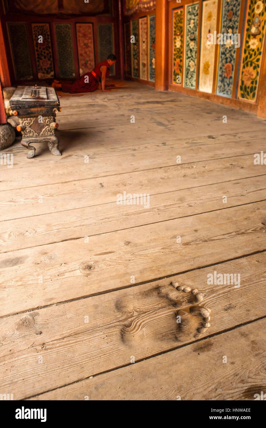 Footprints worn into floorboards outside Longwu Monastery Stock Photo