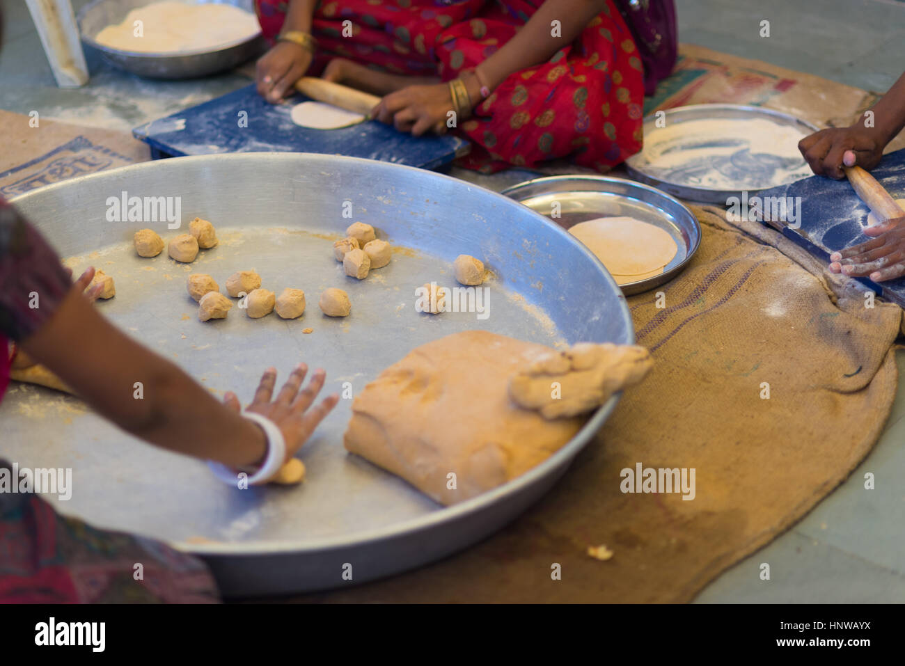 Women Making Indian Flat Bread Called Chapati On A Big Silver Stock Photo Alamy