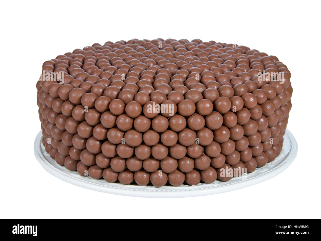 Chocolate Birthday Cake decorated with candy malt balls. Fast and easy home made cake for children or adult birthday - Stock Image