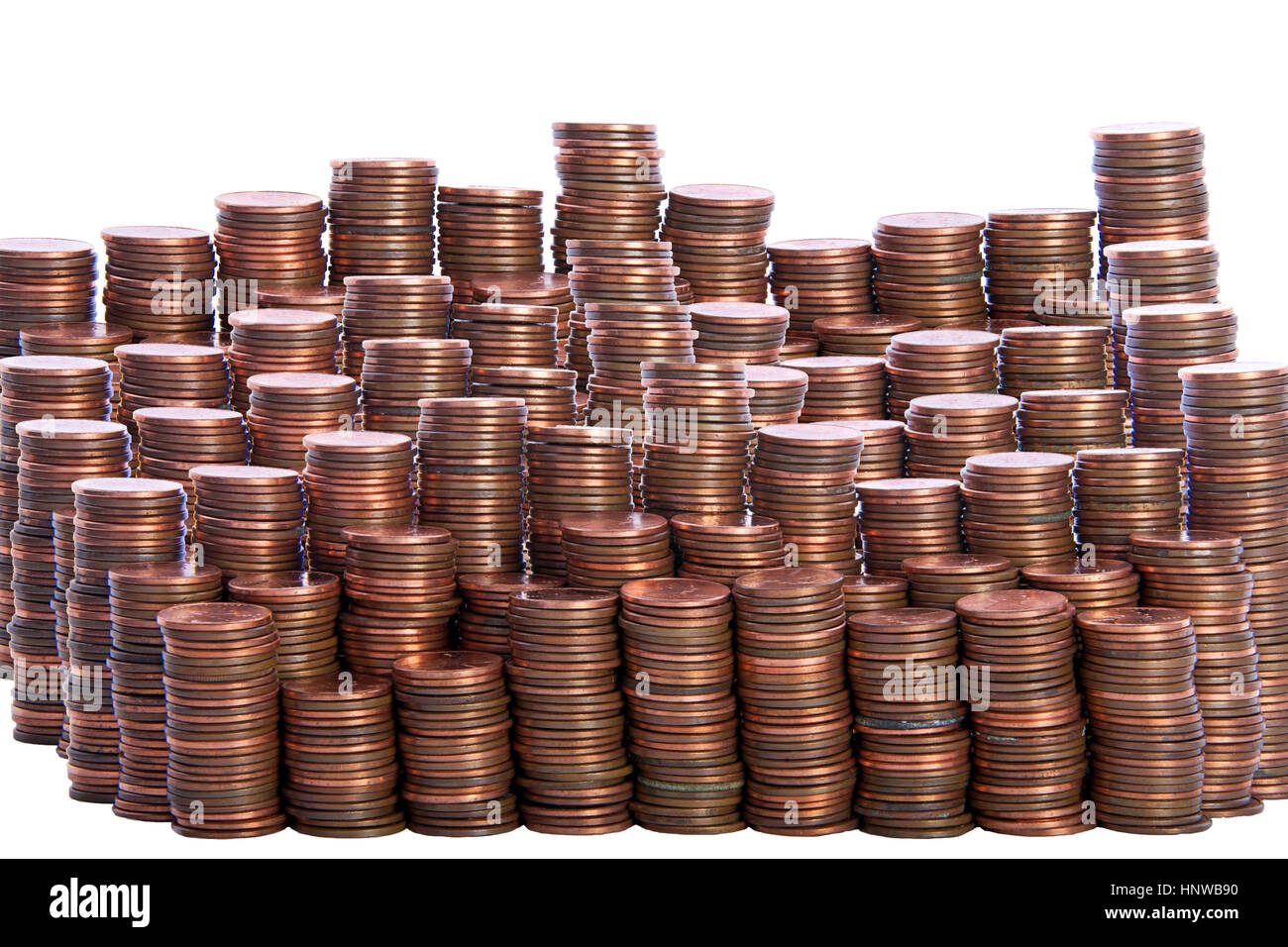multiple stacks of old dirty pennies. bronze and copper pennies isolated on a white background Stock Photo