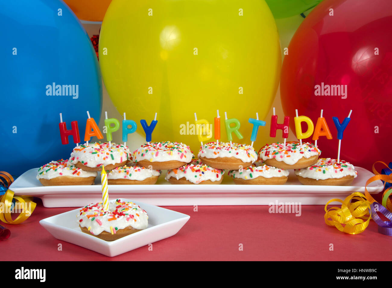 Miniature Donut Cake On Long White Plate With Happy Birthday Candles One Single Square Blue Candle Perfect First