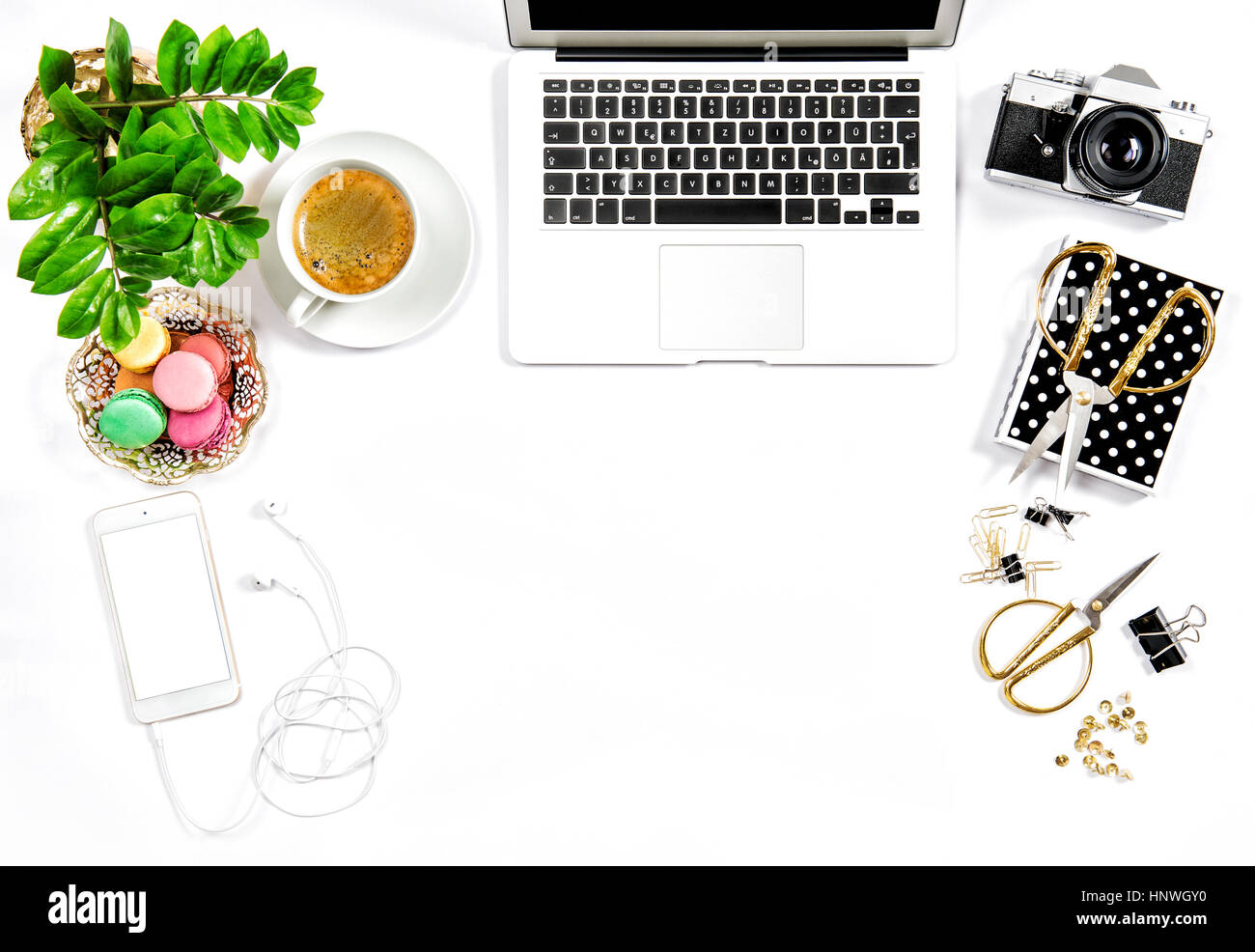 Office Supplies, Laptop, Photo Camera. Coffee And Macaroon Cookies. Feminine  Workplace Flat Lay