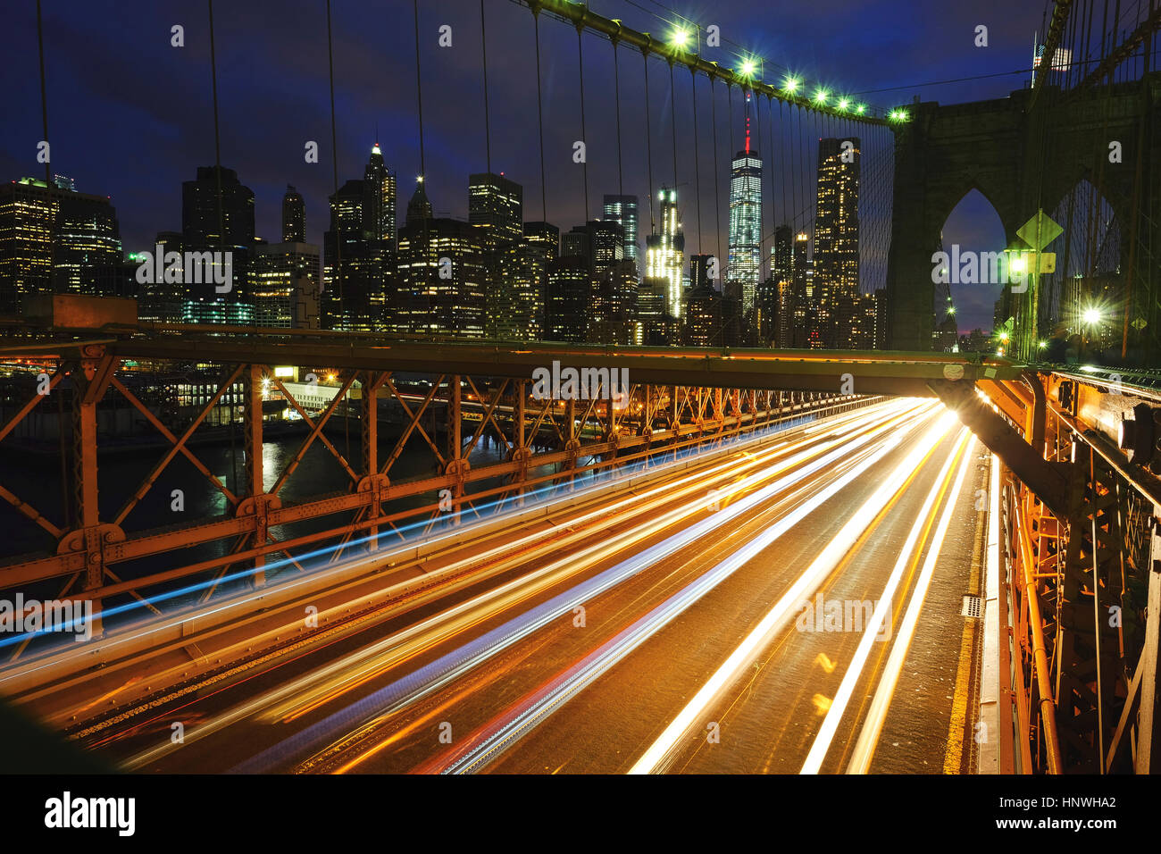 Light trails on Brooklyn bridge, New York, USA - Stock Image