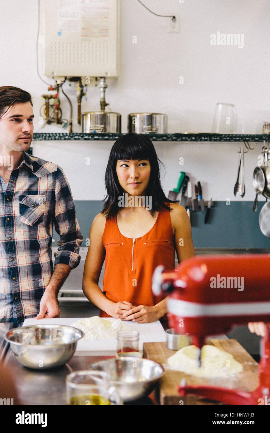 Students at pasta making class - Stock Image