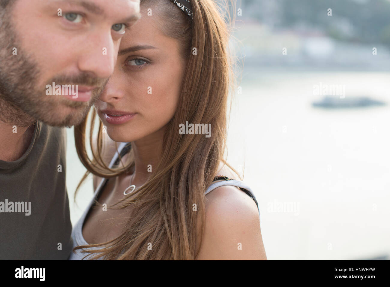 Portrait of sultry young couple on waterfront,  Budapest, Hungary - Stock Image