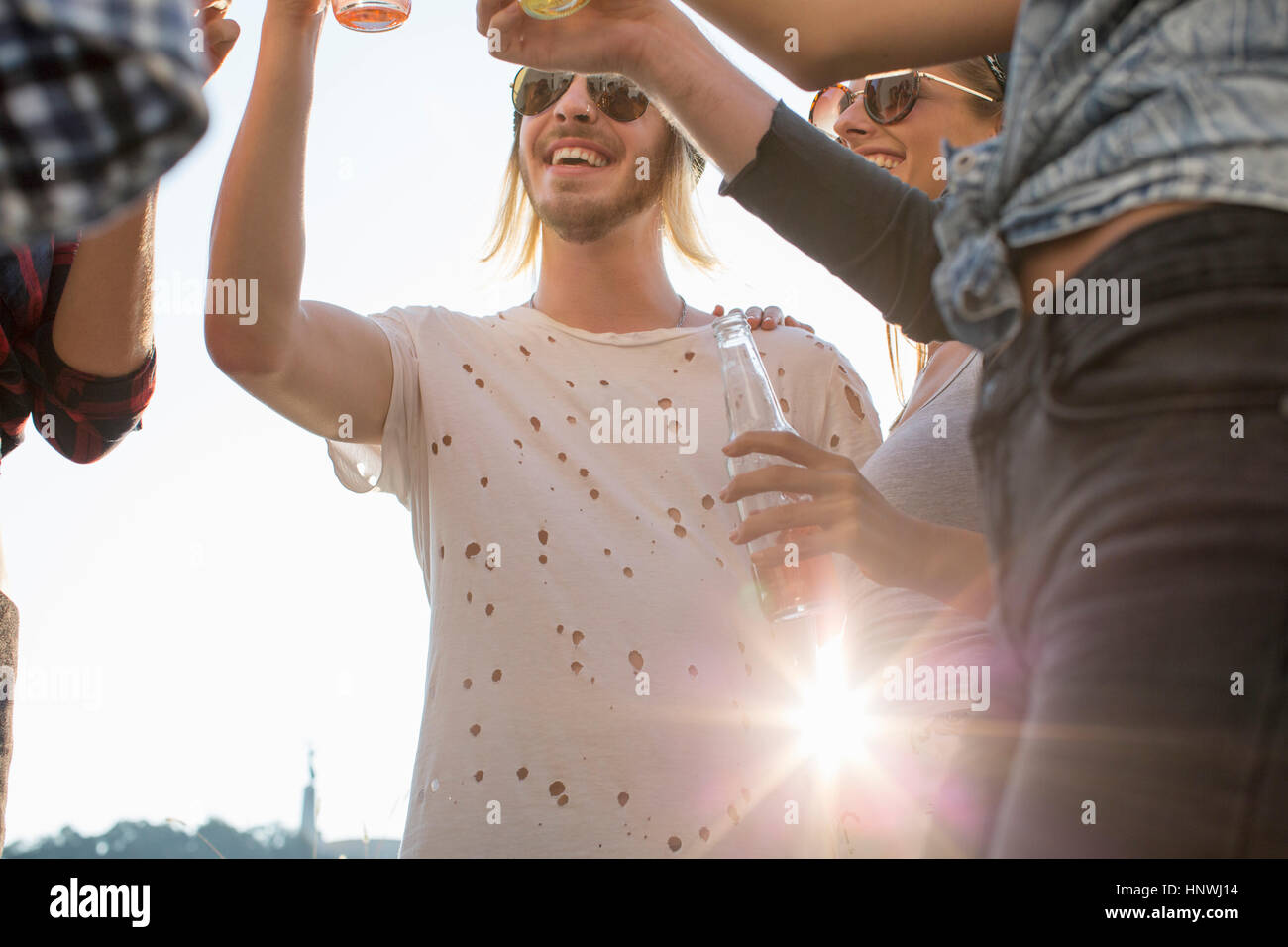 Adult friends partying on roof terrace - Stock Image