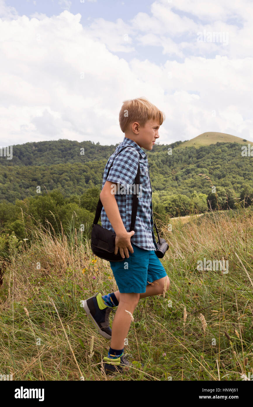 Young boy exploring outdoors - Stock Image