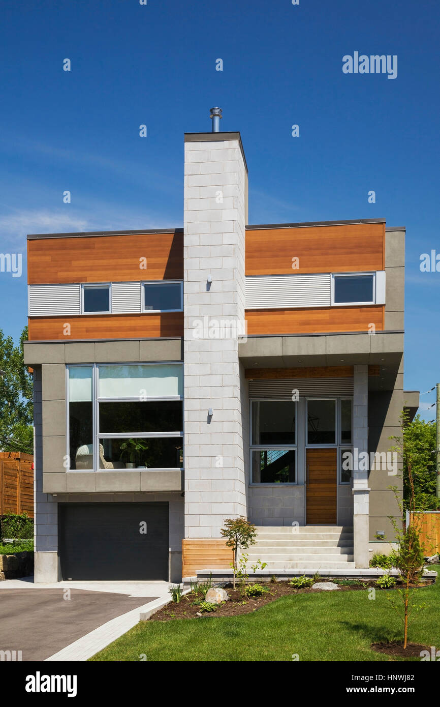 Grey And Charcoal Stone With Cedar Wood Siding Modern Cube Style Home  Facade In Summer,