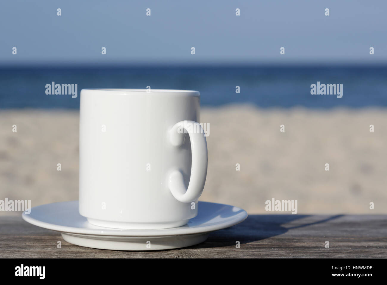 White Mug On A Saucer Stands On A Wooden Table Which Can Be Seen On