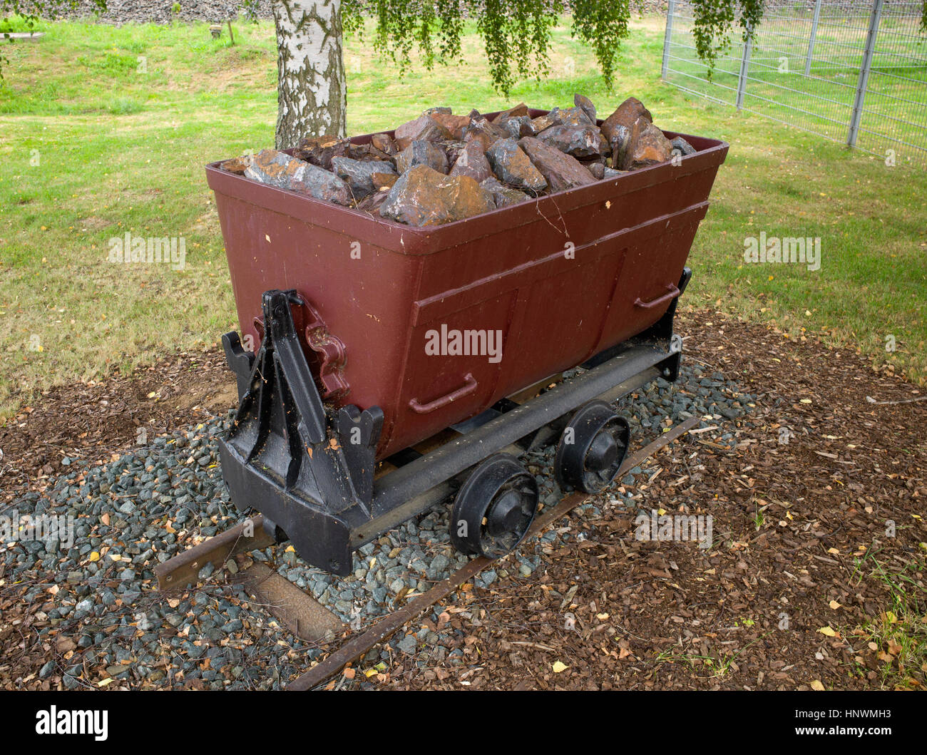 Wagon filled with iron ore from Grube Fortuna iron ore mine on display in Solms, Germany - Stock Image