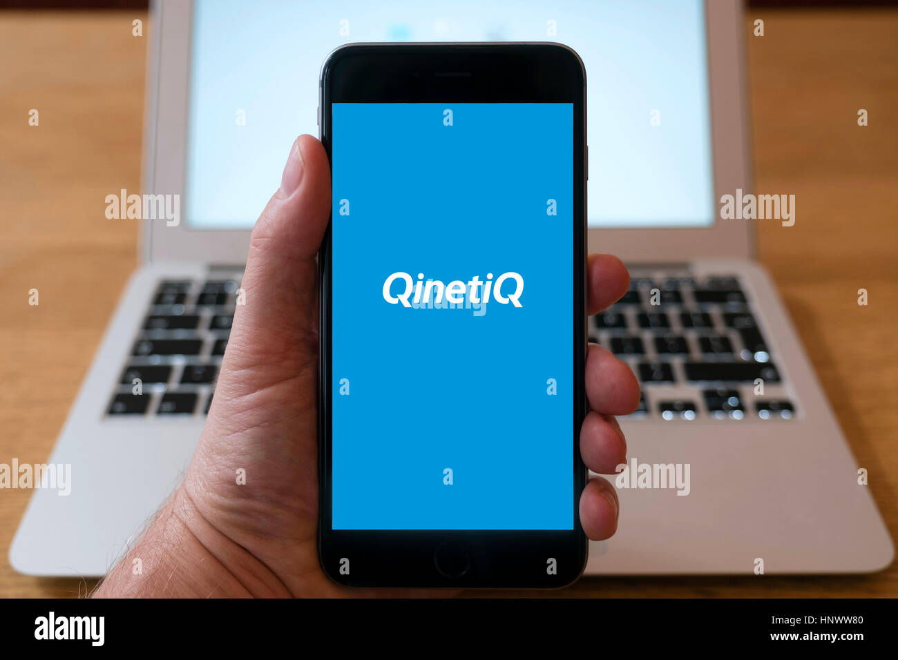 Logo of Qinetiq defence industry group  on smart phone screen. - Stock Image