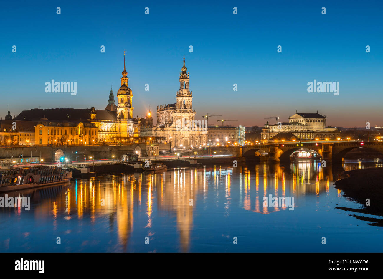 Night skyline of city of Dresden and Elbe River in Saxony, Germany. - Stock Image