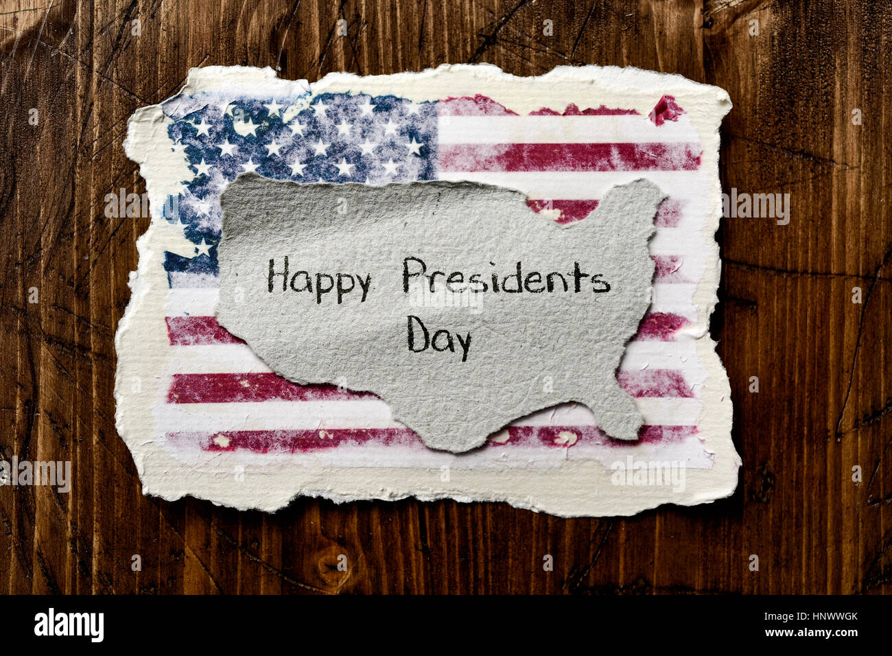 the flag of the United States in an aged piece of paper and the text happy presidents day written in a piece of - Stock Image