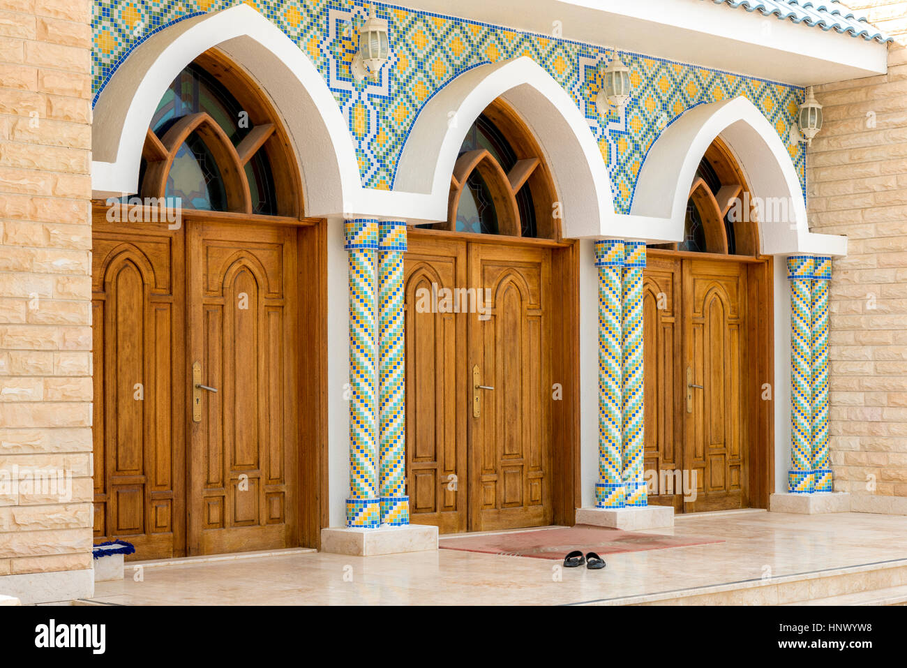 Mosque Entrance. Main Entrance Doors To An Islamic Mosque In Al Ain, United  Arab Emirates With Traditional Tiles And Woodwork