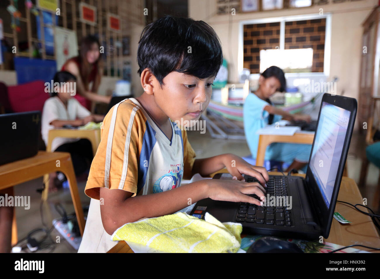 Computer classes at the Lindalva daycare center for children of the textile workers in Phnom Penh, Cambodia, Asia - Stock Image