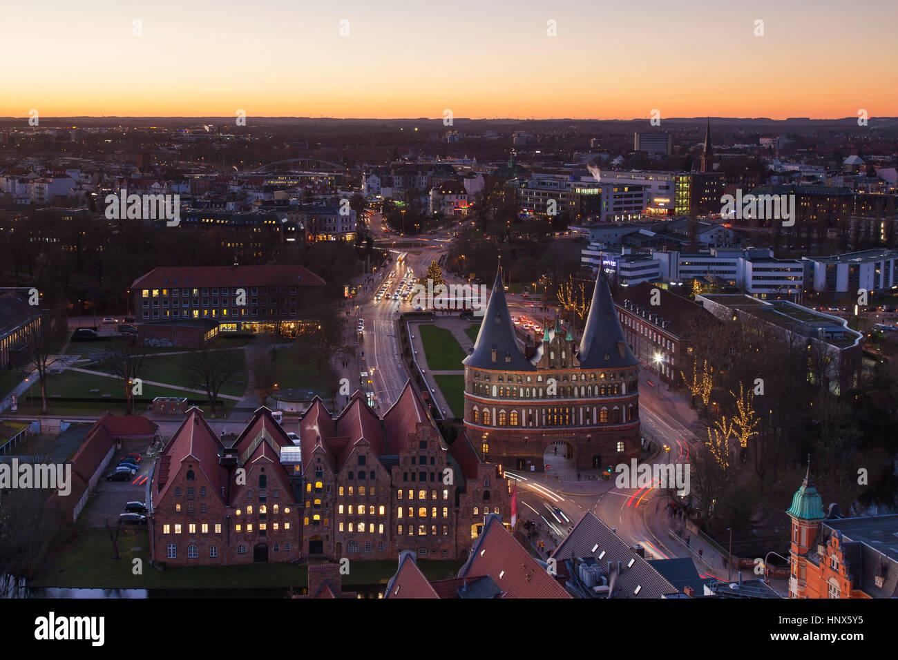 Bird's eye view at dusk over the Holsten Gate / Holstein Tor / Holstentor, Brick Gothic city gate at the Hanseatic - Stock Image