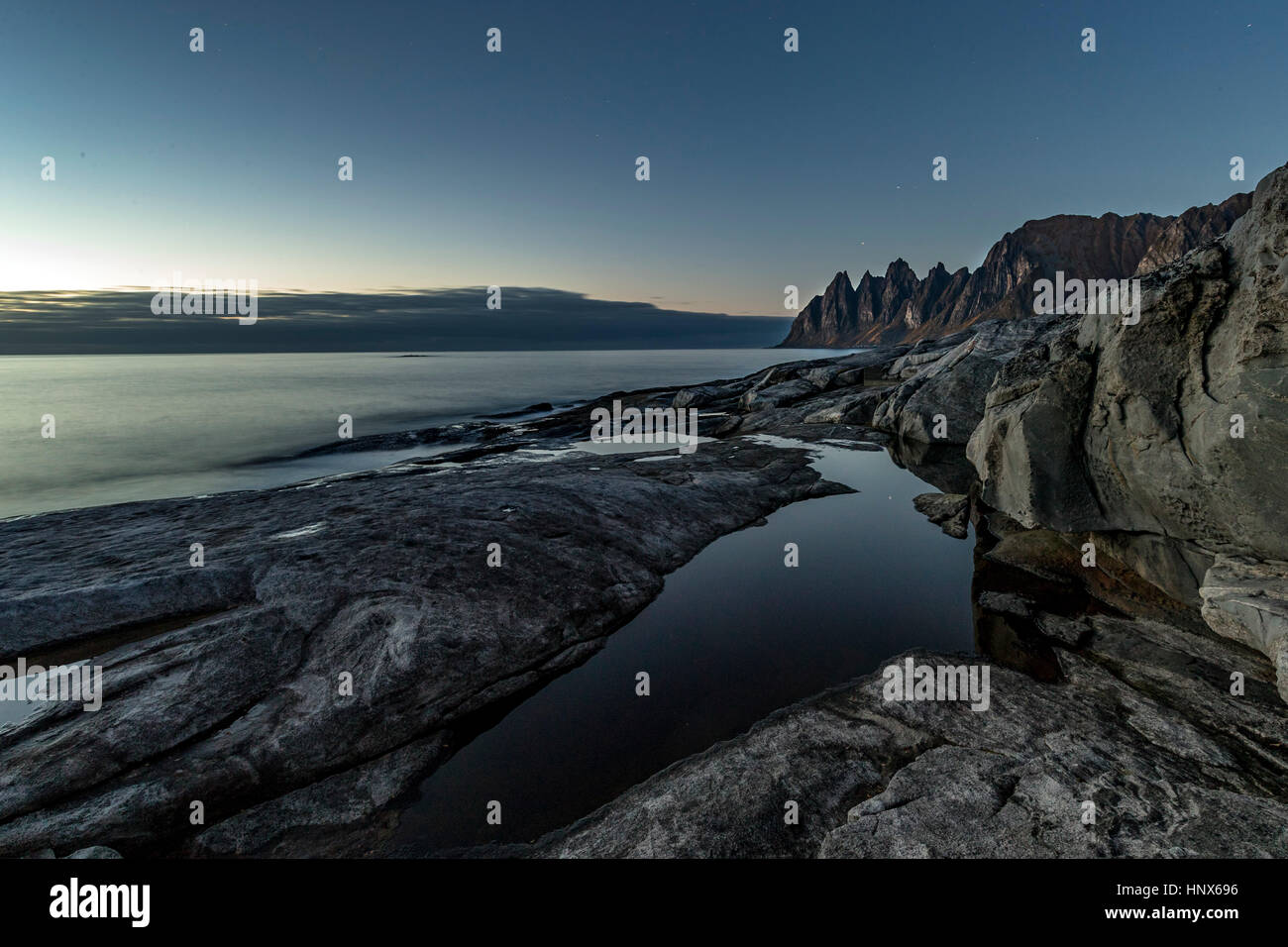 View over the sea towards Okshornan from Tunganeset on Senja Island in autumn, Arctic Norway - Stock Image