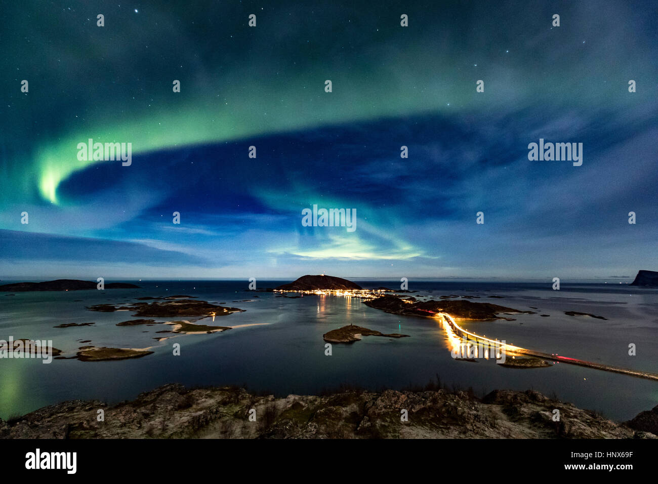 Aurora Borealis in the night sky over Sommaroy Bridge crossing from Kvaloya Island to Sommaroy island, Arctic Norway - Stock Image