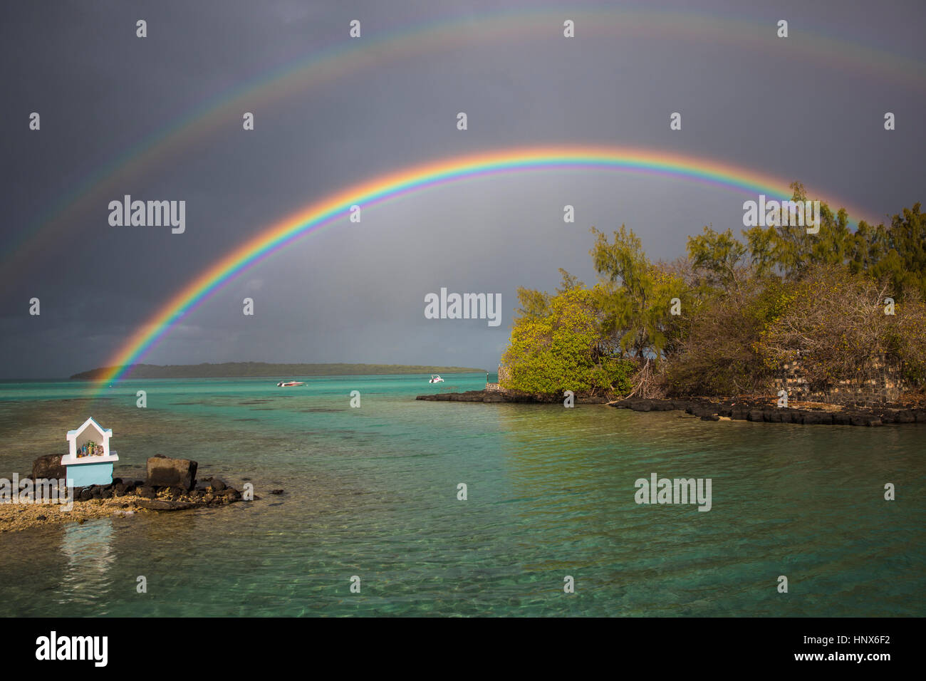 Rainbows over water, Pointe d'Esny, Mauritius - Stock Image