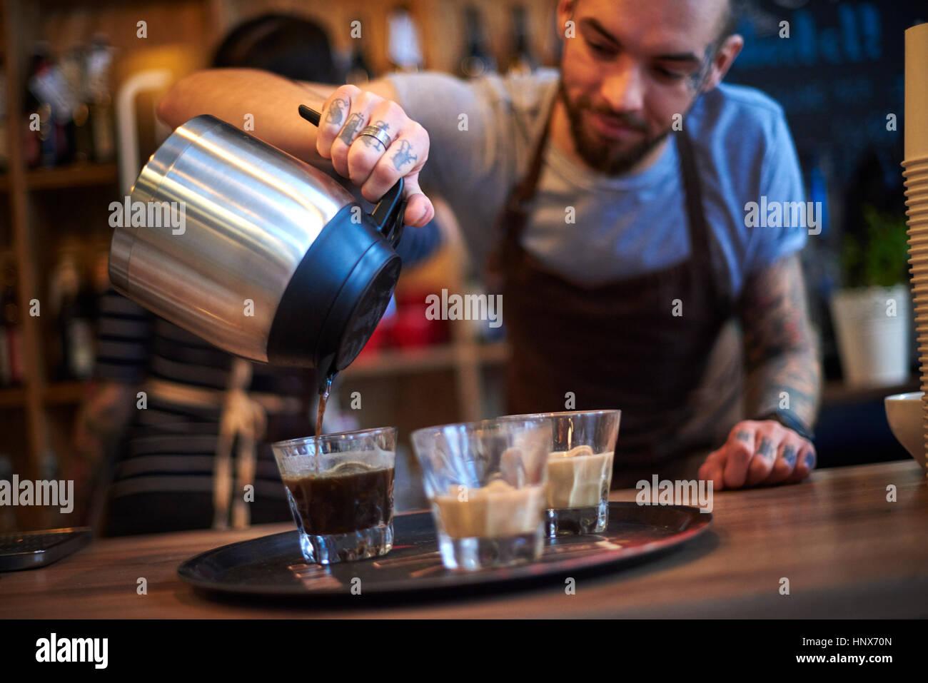 Barista making coffee - Stock Image