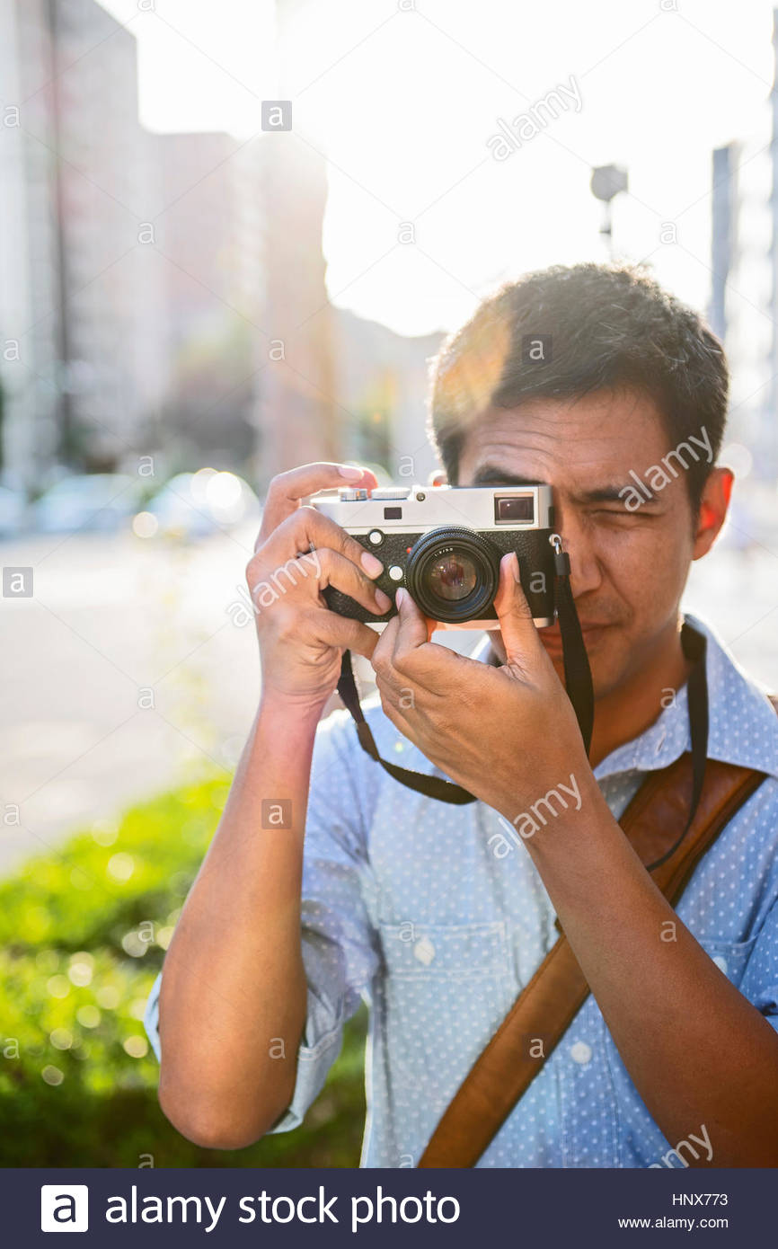Man taking picture with a digital rangefinder camera, Kyoto, Japan - Stock Image