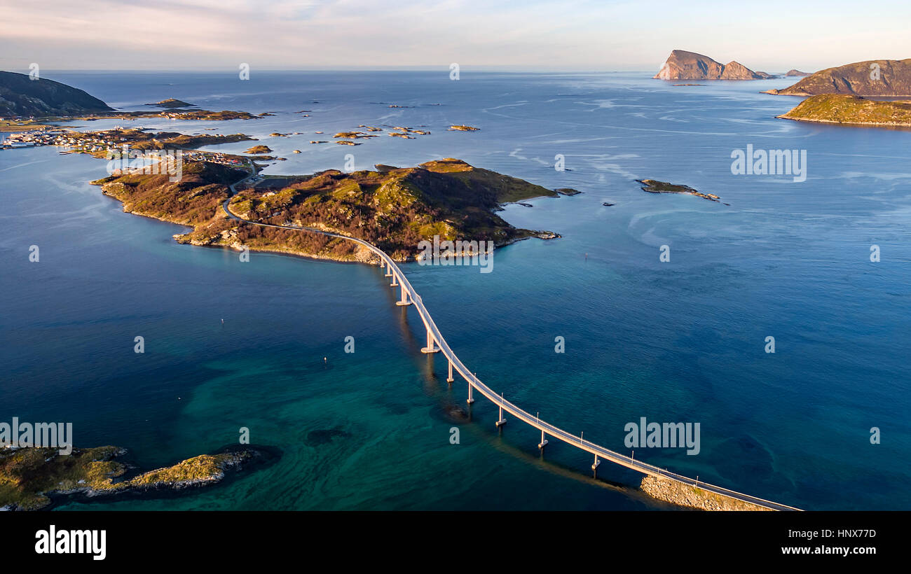 Aerial view of famous Sommaroy Bridge crossing from Kvaloya Island to Sommaroy Island in autumn, Arctic Norway - Stock Image
