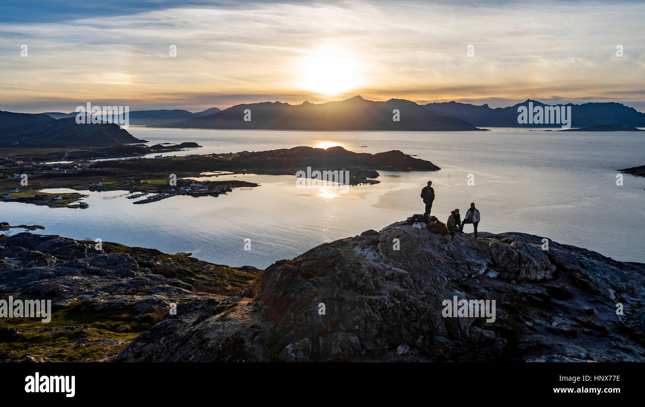 Aerial view of group of people climbing a summit on Kvaloya Island in autumn, Arctic Norway - Stock Image