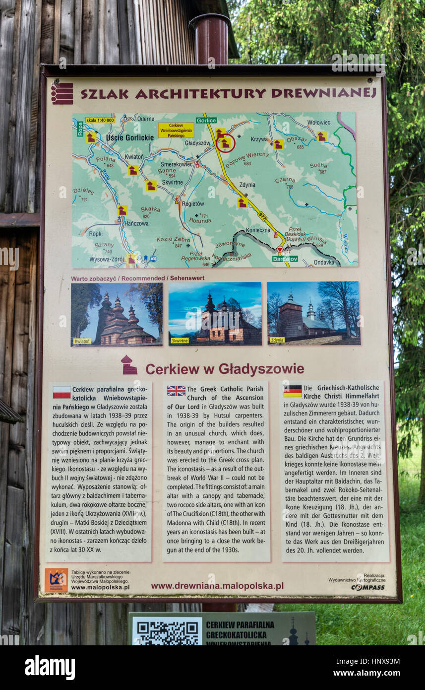 Multilingual information sign at Ascension of Our Lord Church, 1939, Greek Catholic, in village of Gladyszow, Malopolska, - Stock Image