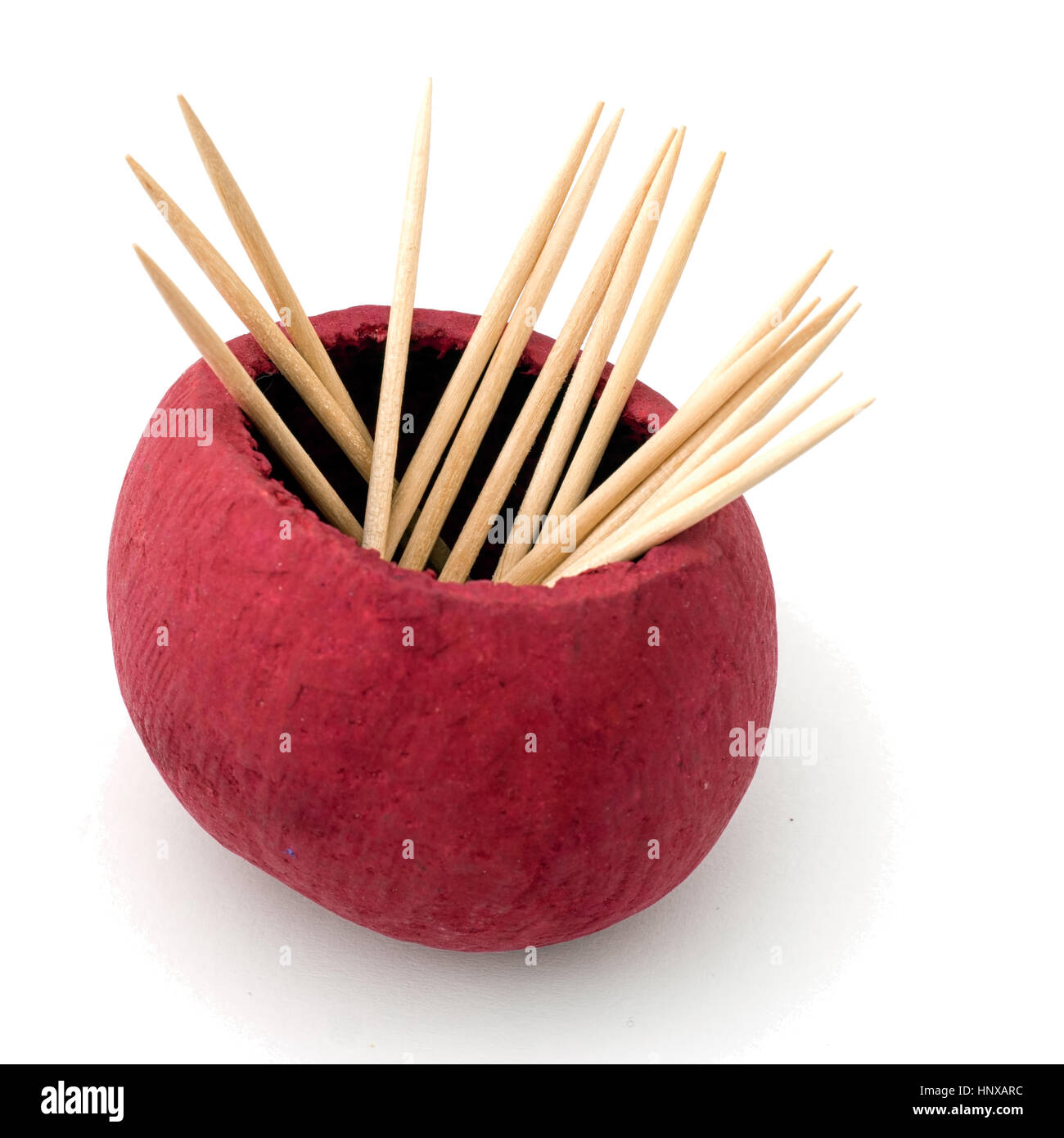 Toothpicks, cocktail sticks in red pot. On white. - Stock Image