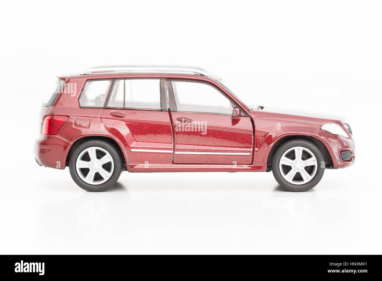A model car is seen with Euro currency units. - Stock Image