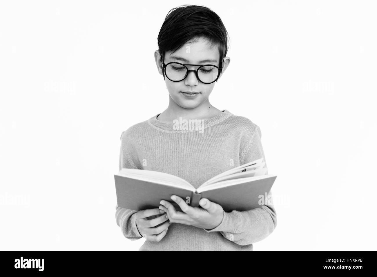 Boy Read Book Nerd Concept - Stock Image