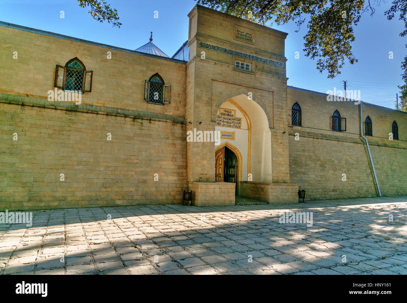 Juma Mosque - the most ancient mosque in Russia. Old trees Platanus orientalis in the yard. Derbent. Republic of - Stock Image