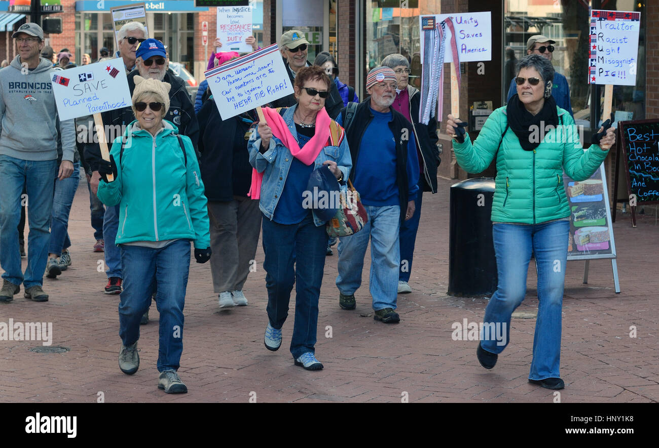 Marchers during protest of president Trump's policies in Boulder, Colorado - Stock Image