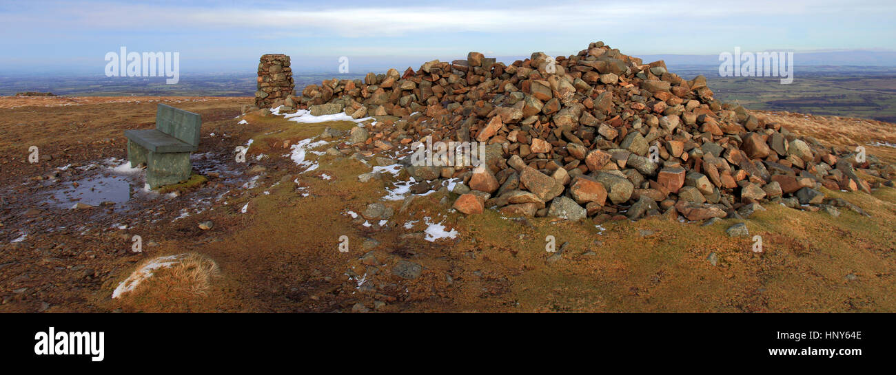 Ordinance Survey trig point and summit cairn on High Pike fell, one of the 214 Wainwright Fells, Caldbeck fells, Lake District National Park, Cumbria  Stock Photo