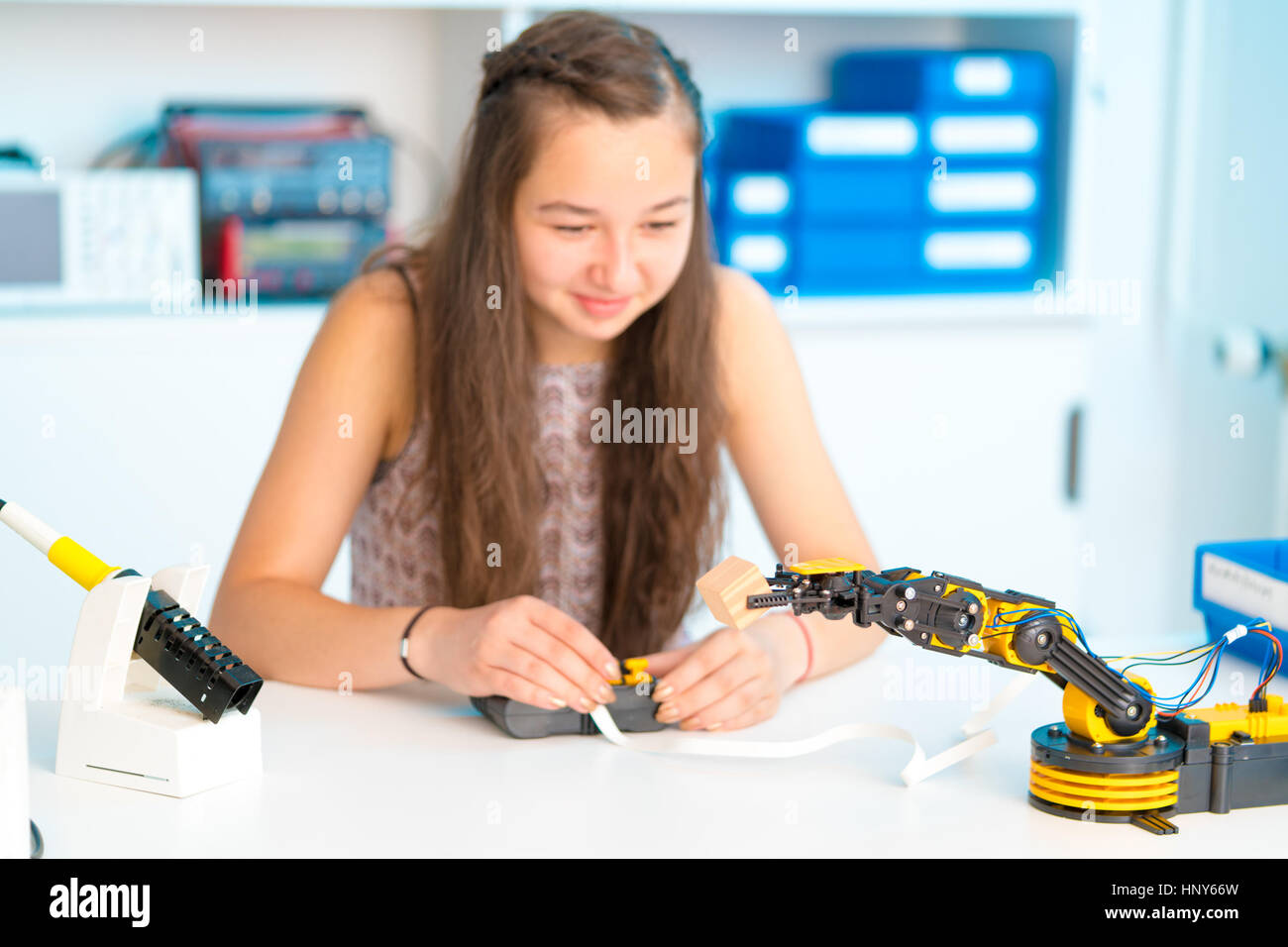 Teen girl in robotics laboratory,  school class - Stock Image
