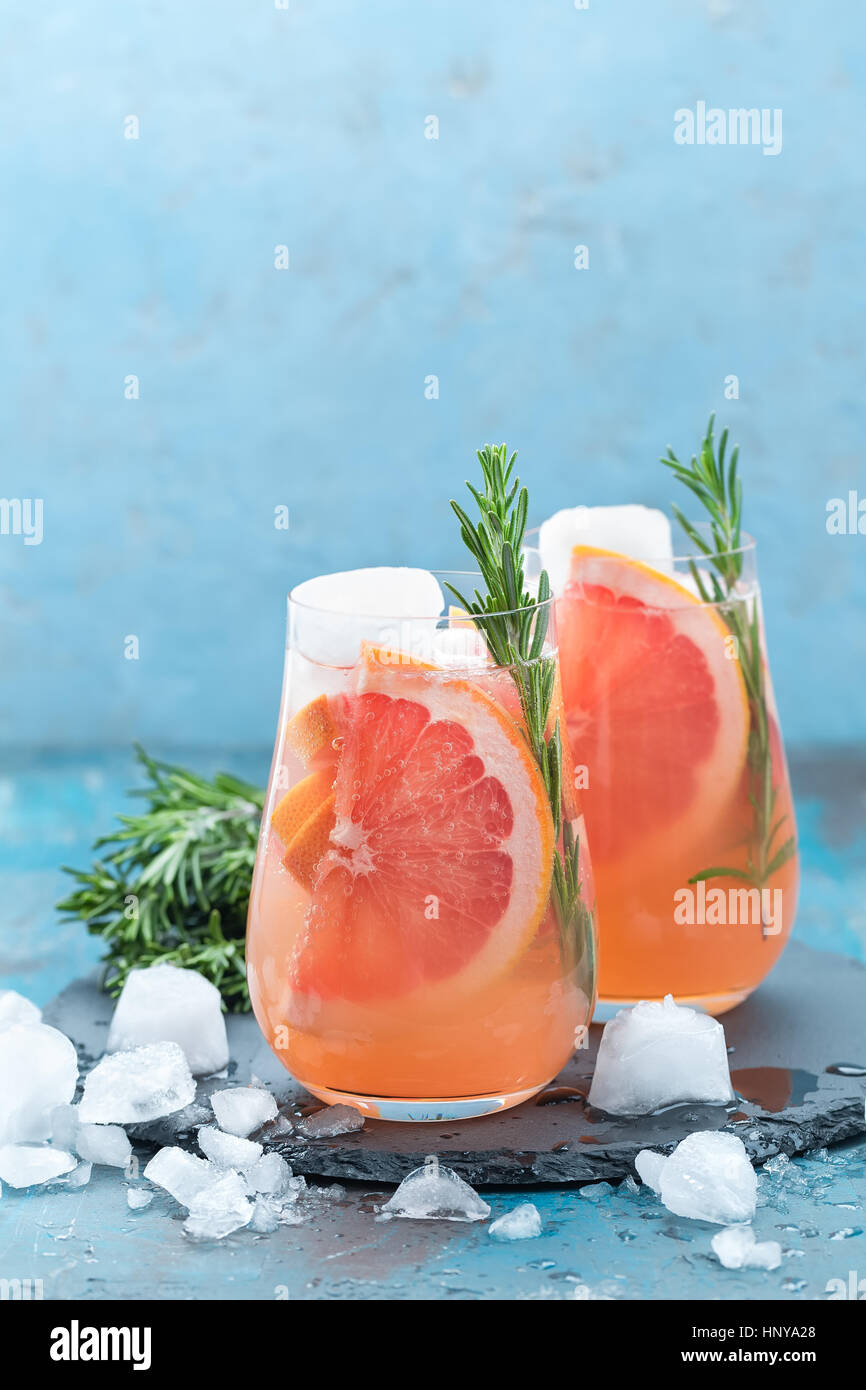Grapefruit and thyme gin cocktail, refreshing drink with ice - Stock Image