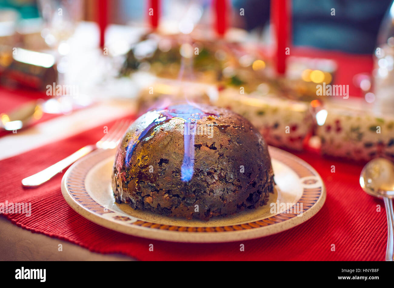 Christmas pudding flaming with brandy - Stock Image
