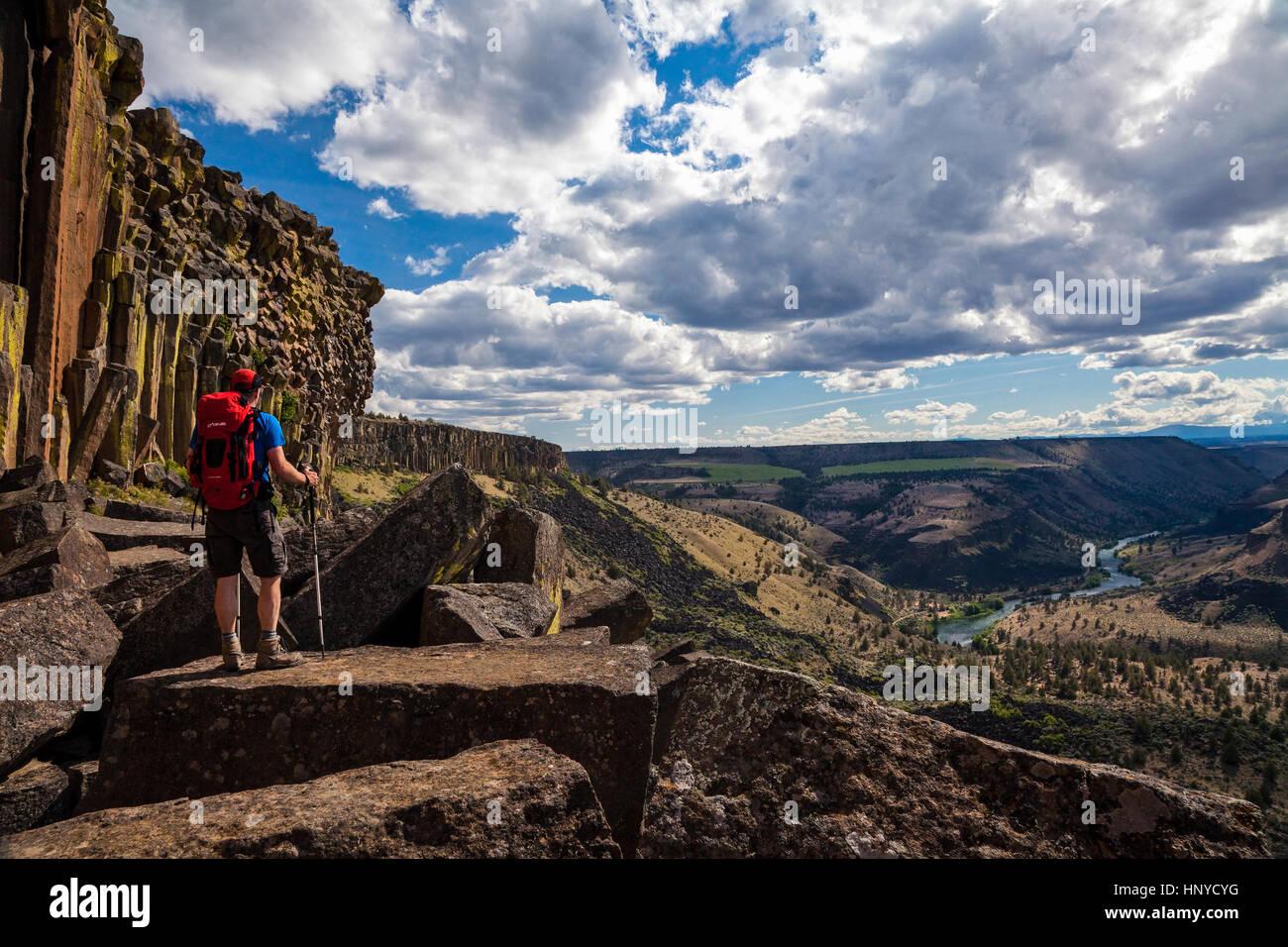 Hiker On Cliffs Above the Deschutes River Near Madras, Oregon - Stock Image