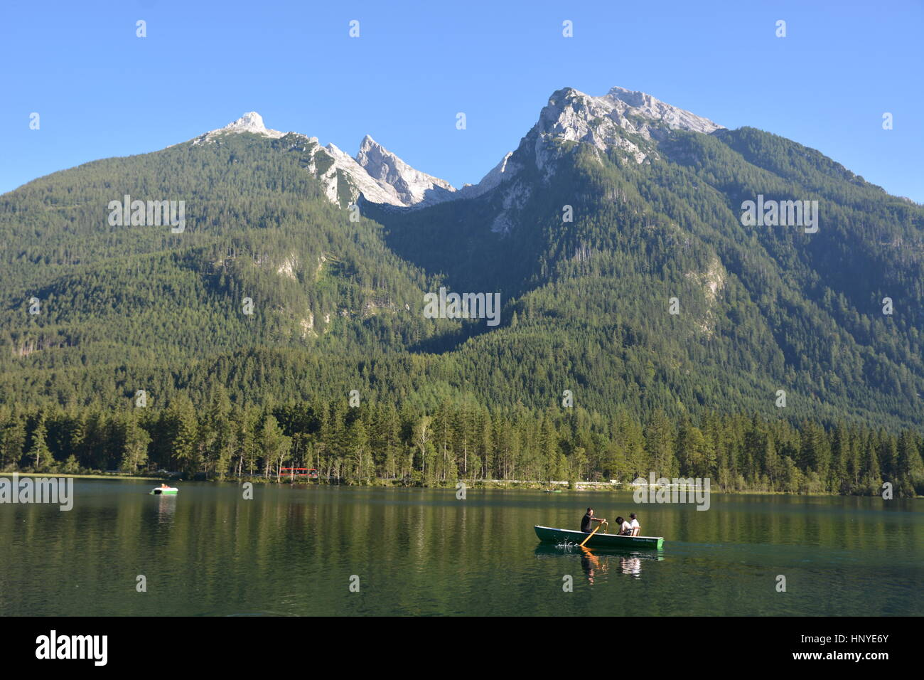 Ramsau, Germany - August 24, 2016 -  Beautiful lake Hintersee with boats and mountain Hochkalter Stock Photo