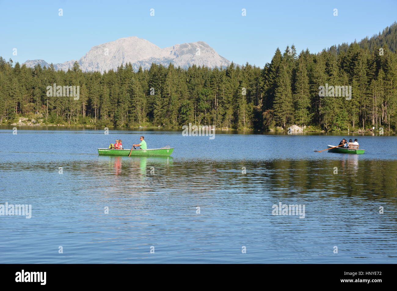 Ramsau, Germany - August 24, 2016 -  Beautiful lake Hintersee with boats and mountains Hoher Goell and Hohes Brett Stock Photo
