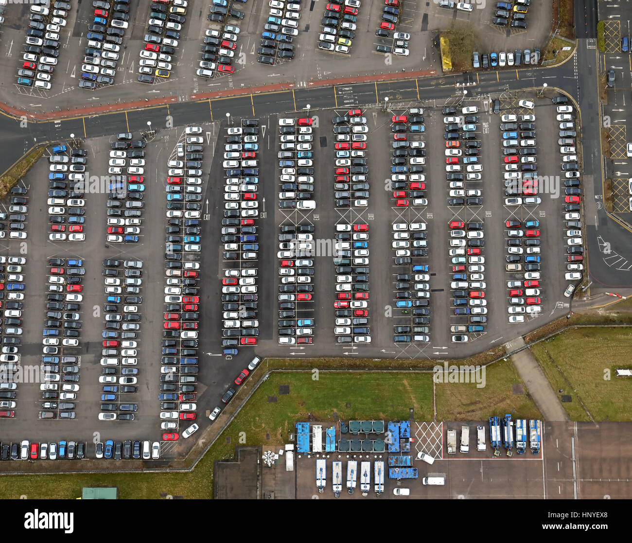 vertical aerial view of cars parked at Manchester Airport car park - Stock Image