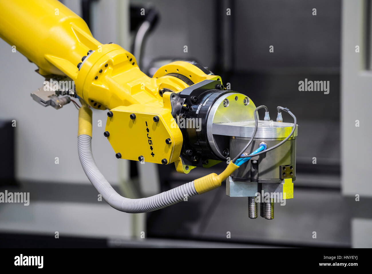 Industrial robot with CNC machine. Metal processing industry - Stock Image