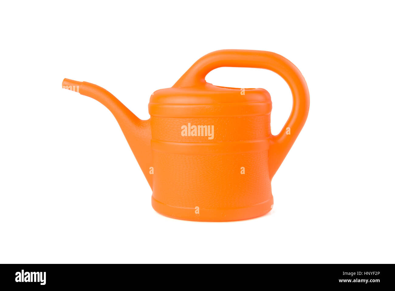orange watering can on white background studio shot - Stock Image