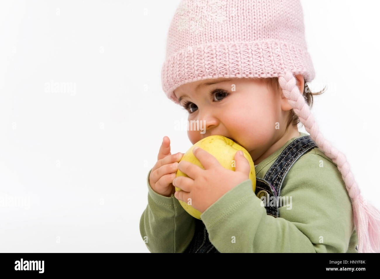 little child eats apple stock photos little child eats apple stock images alamy. Black Bedroom Furniture Sets. Home Design Ideas